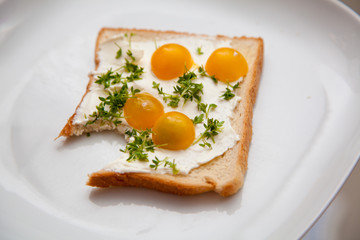 toast with cream cheese yellow tomatoes and cress