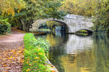 British autumn landscape. Old bridge on the canal