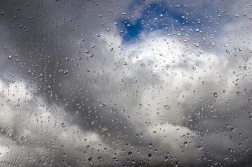 Raindrops on glass closeup