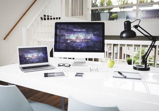 Laptop and Desktop Computer at an Office Desk Mockup 1