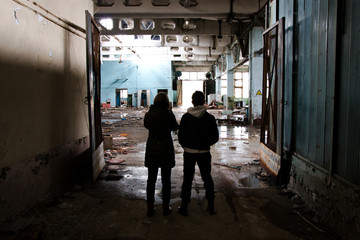 People looking at ruined factory