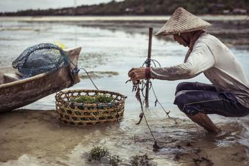 Fisherman working in river