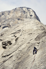 Low angle view of woman climbing a mountain