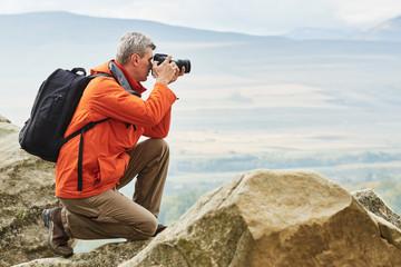 professional photographer at mountains. Georgia