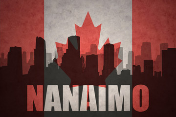 abstract silhouette of the city with text Nanaimo at the vintage canadian flag