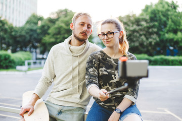 Couple with longboards doing selfie