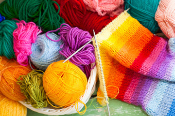 Coloured wool yarn into skeins and tangles. Bright yarn.