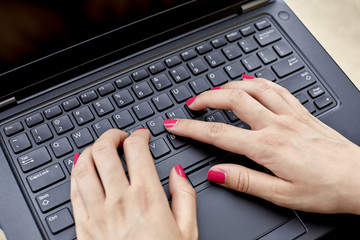 Close up of a Womans Hands on Keyboard