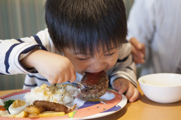 Boy is eating a hamburger open the big mouth