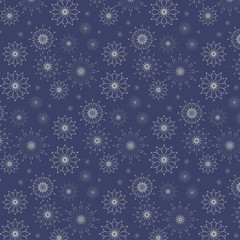 Winter pattern from gray snowflakes on a blue background.