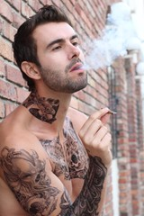 Man Smoking A Cigarette While Looking Away