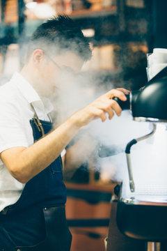 Bartender steaming wand