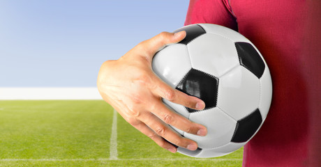 soccer player holding the ball
