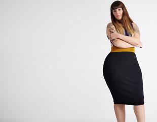 plus size model wears dress showing her curvy body
