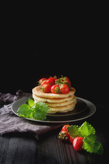 Door stickers Dessert Stack of homemade Pancakes with fresh Wild Strawberries on a pla