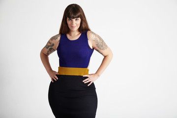 beauty plus size woman with tatooed arms and omre hair