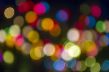 Colorful holiday Christmas lights background in bokeh bubbles