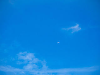 cloudscape blue sky and mini half moon on sunny day