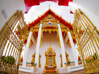 outdoor roadside public temple, Chaithararam Temple Wat Chalong at Phuket Thailand, the temple has created with money donated by people to hire artist no restrict in copy or use