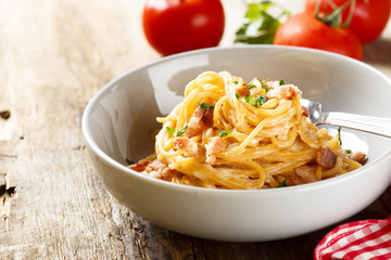 Tomato pasta with egg sauce, cheese and ham