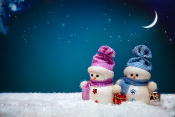 Couple of snowmen on blue winter background