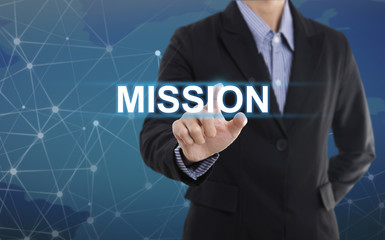 Businessman hand pressing button mission. sign on virtual screen. business concept.