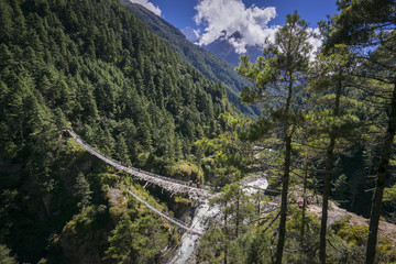 High view of of Hillary Suspension Bridges, New one and old one lower. Everest region, Nepal