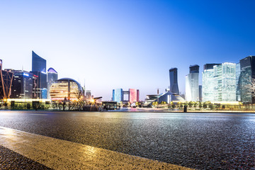 Fotomurales - cityscape and skyline of hangzhou new city from empty road