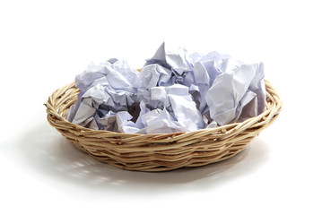 Crumpled paper ball on basket - white background