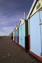 Long row of beach huts on Brighton seafront, Brighton, England,
