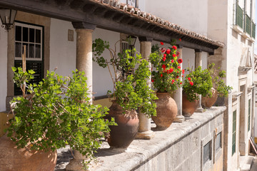 Big ceramic pots between the columns at the terrace of old house