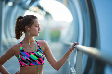 Confident and athletic young woman concentrating before exercise.