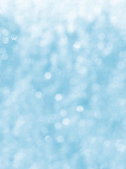Light blue background, bokeh, vertical