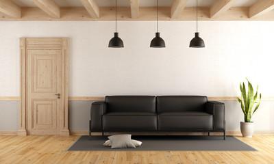 living room with wooden door and sofa
