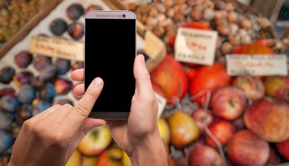 mobile phone in the fruit market.