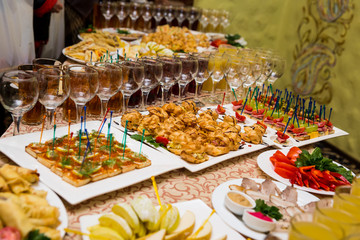 catering banquet table, Canapes on restaurant table, catering, buffet, canapés, stemware, snacks, glasses with juice, champagne glasses