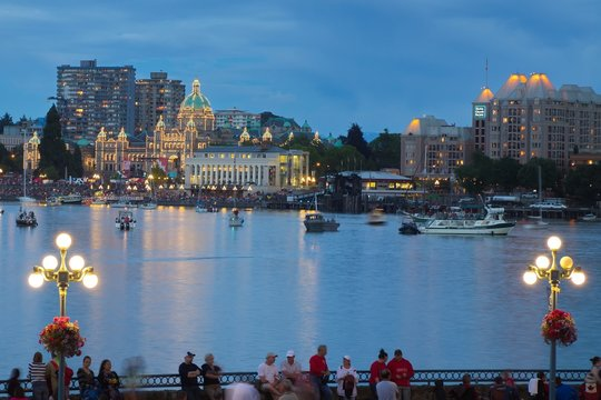 Victoria city, Canada - Canada Day of 2016: View of Victoria city Inner harbor with crowds waiting for fireworks display.