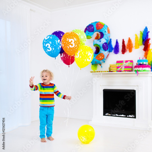 """""""Little Boy Opening Birthday Presents"""" Stock Photo And"""