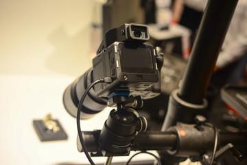 Professional digital camera shooting object in studio