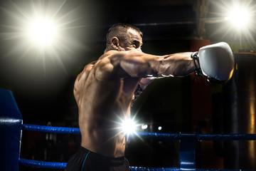 punching boxer on boxing ring