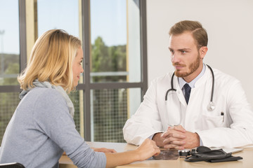 Doctor consulting patient in office