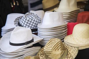 close up on  hats of felt for sale at a flea market