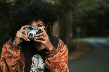 girl with vintage photo camera outdoor