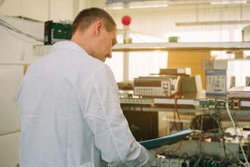 Microchip production factory. Computer expert. Chip. Professional. Technician. Manufacturing. Engineering. Technology.
