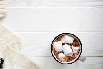 Cup hot chocolate with marshmallows in a ceramic cup on white wo