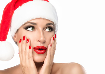 Christmas woman in Santa hat with a surprise expression isolated