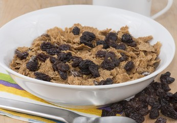 Healthy breakfast cereal with raisins in a bowl