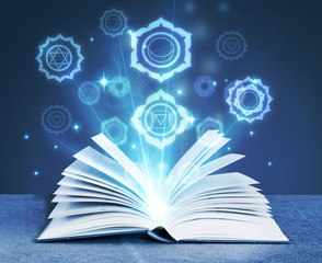 book with magic symbols