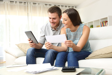 Happy couple checking bank account online