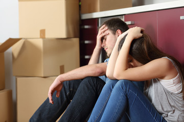 Sad evicted couple worried moving house